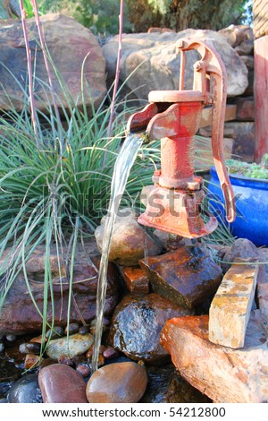 Vintage water well - stock photo