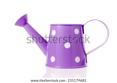 Vintage watering can with purple color and polka dots isolated on white background. - stock photo