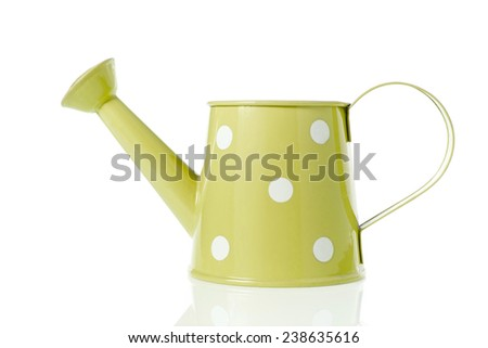 Vintage watering can with yellow color and polka dots isolated on white background. - stock photo