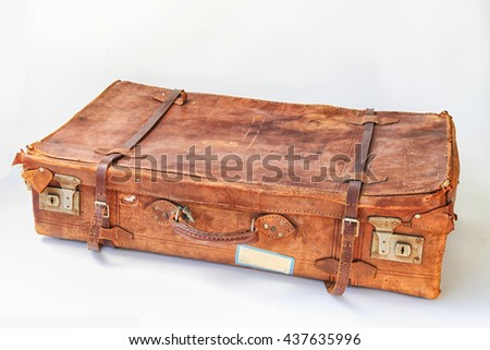 Vintage weathered leather suitcases sideview - stock photo