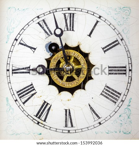 Vintage weathered white clock face with roman numbers - stock photo