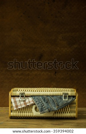 Vintage weave baggage for travel with old steel background