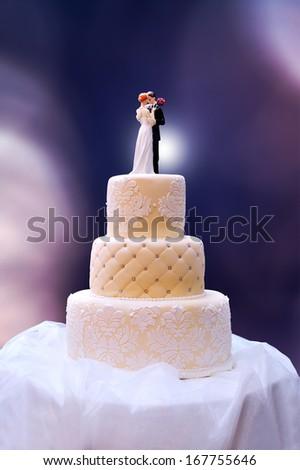 Vintage wedding cake of three tiers - stock photo