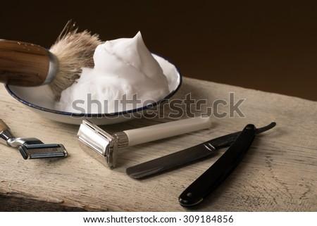 vintage wet shaving Equipment on wooden Table - stock photo