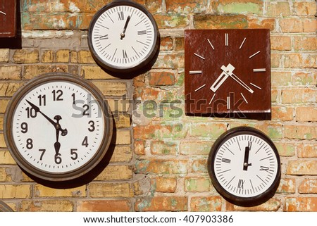 Vintage white and brown clock on brick wall background - stock photo
