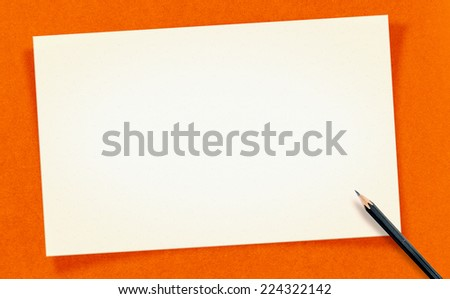 Vintage white Blank Card with pencil on orange craft paper, Mock up for your text - stock photo
