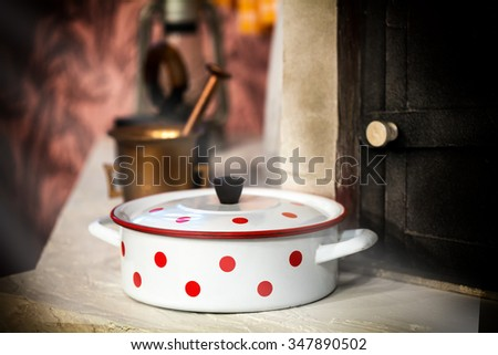 Vintage white cooking pot with red dots  - stock photo