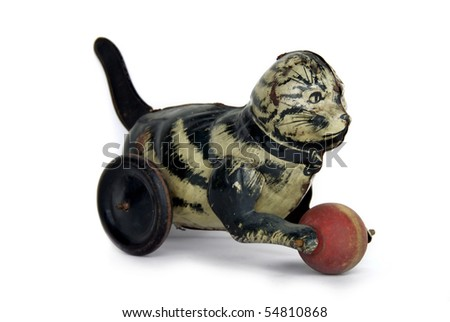 Vintage wind-up tin cat toy with ball - stock photo