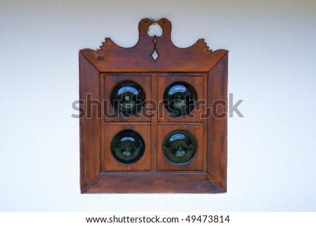 Vintage window is made in Ukrainian folk style of 17th century. It is wooden with round glass pieces and decorated with wood pigeons.
