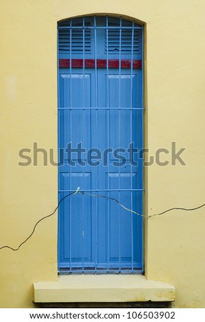 Vintage window on cement wall - stock photo