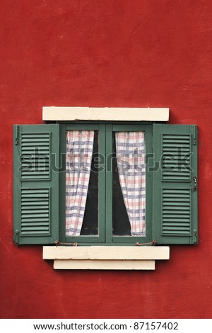 Vintage window on red cement wall can be used for background - stock photo