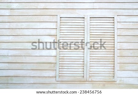 Vintage window on wooden wall. - stock photo