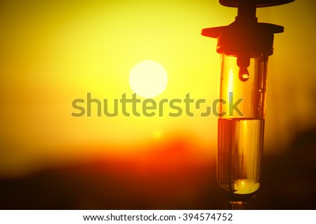 vintage with sunset iv fluid use for intravenous volume in patient dehydration - stock photo