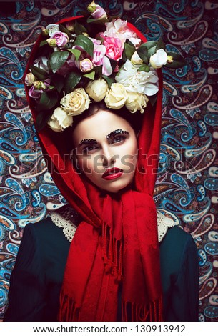 Vintage. Woman in Red Shawl and wreath of Roses. Retro - stock photo
