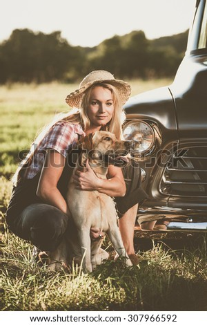 Vintage woman with dog - stock photo