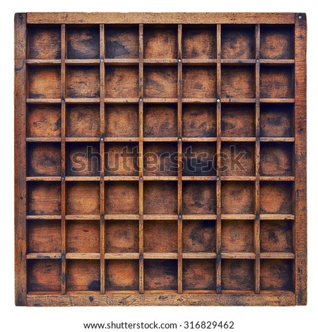 vintage wood  printer  (typesetter) drawer or shadow box with numerous dividers, isolated on white - stock photo