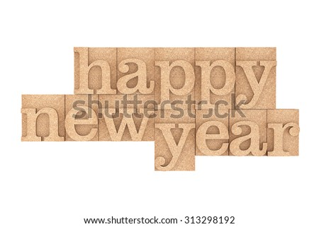 Vintage wood type Printing Blocks with Happy New Year Slogan on a white background - stock photo