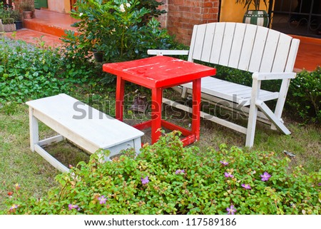 Vintage wooden bench in the garden - stock photo