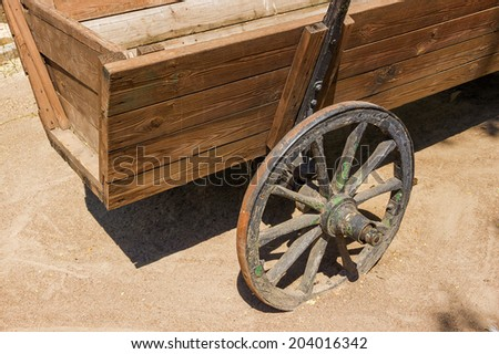 vintage wooden cart on sand - stock photo