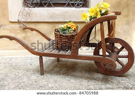 Vintage wooden cart with yellow flowers