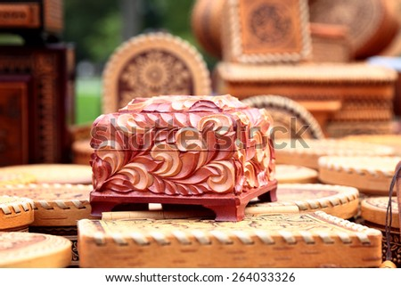 vintage wooden casket with carved floral ornament - stock photo