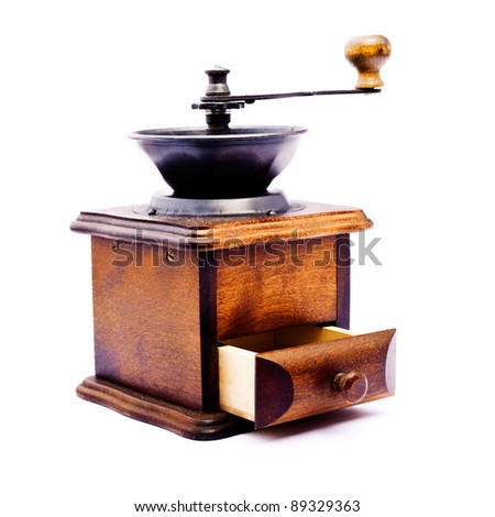 Vintage wooden coffee mill grinder with open drawer - made in studio isolated on white background - stock photo