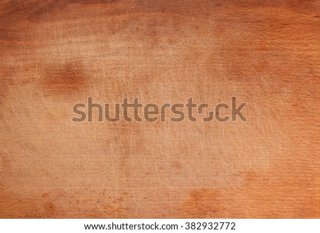 Vintage wooden cutting board with lots of scratches, texture background, copy space. Old grunge wooden cutting kitchen desk board background texture