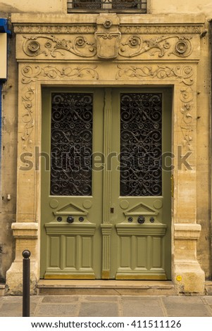 Vintage wooden door on apartment in Paris, France - stock photo