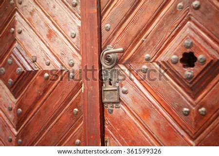 Vintage wooden door with lock close up
