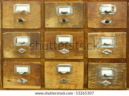 Vintage wooden drawer with blank labels - stock photo