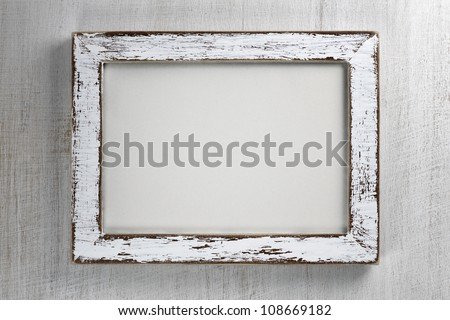 Vintage wooden frame on wall background - stock photo