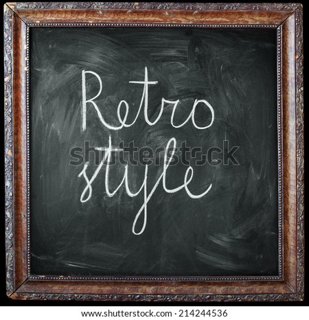 "Vintage Wooden Frame with a Flower Pattern, above Chalkboard and text ""Retro style"", isolated on black"
