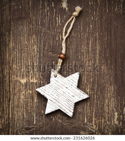 Vintage Wooden Star Christmas Decoration on Wooden Background - stock photo