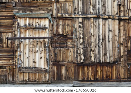 Vintage wooden wall with a door - stock photo
