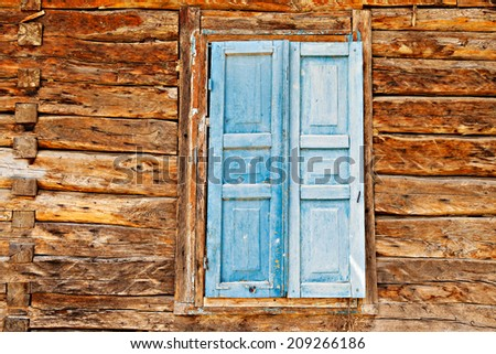 Vintage wooden wall with a window  - stock photo