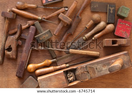 Vintage woodworking tools, including planes, chisels, whittling tools.  Most of these are hand-made. - stock photo
