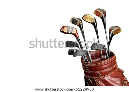 Vintage worn Golf clubs in an old bag isolated over a white background with a clipping path