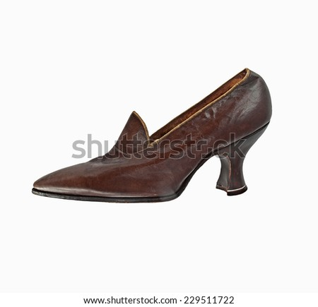 vintage worn women shoe over white, clipping path - stock photo