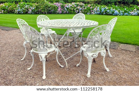vintage wrought iron table. Vintage Wrought Iron Garden Table And Six Chairs In An English Garden. A