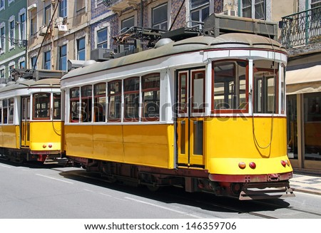 Vintage yellow trams in Lisbon downtown, Portugal  - stock photo