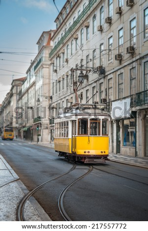 Vintage yellow tramway in the streets of Lisbon - stock photo
