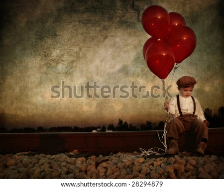 vintage young boy with red ballons