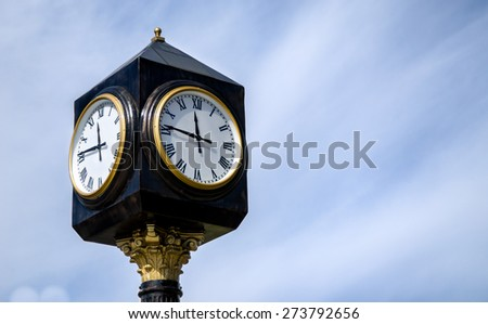Vintege street clock on a poll with negative space on the right - stock photo