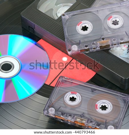 Vinyl disc, audio and video cassettes. Background - stock photo