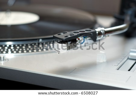 vinyl disk player ready to use. selective focus. - stock photo