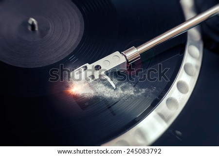 vinyl laying on a record player - scratching the surface - stock photo
