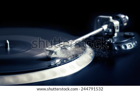 vinyl laying on a record player - scratching the surface - nightclubbing, dj etc