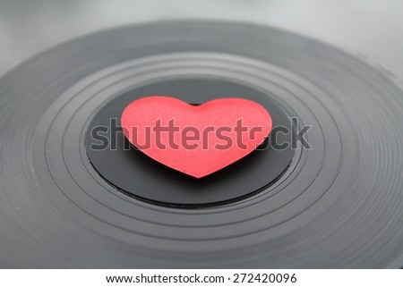 Vinyl Lover - a red love heart on a vinyl record - stock photo