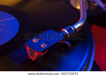 Vinyl record played on a hi-end turntable record player shell and cartridge close up - stock photo