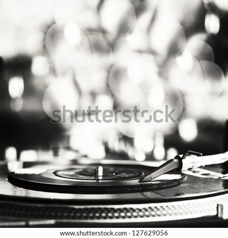 Vinyl record spinning on turntable - stock photo